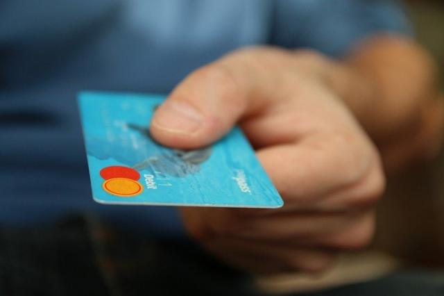 mans-hand-with-credit-card.jpg